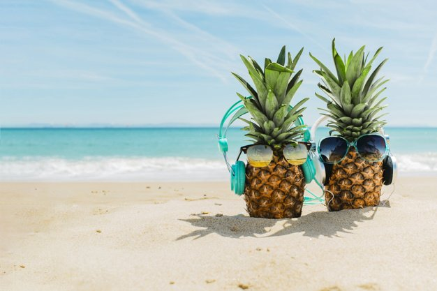 beach-background-with-cool-pineapples-wearing-headphones_23-2147836098.jpg